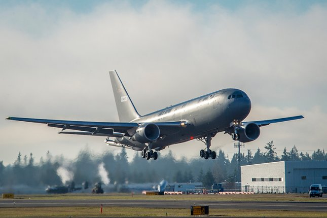 The first KC-46 tanker for the U.S. Air Force takes off from Paine Field in Everett, Wash., on its maiden flight to McConnell Air Force Base in Kansas. Photo by Marian Lockhart/Boeing
