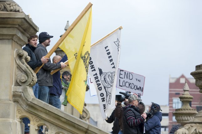 Protesters against COVID-19 lockdowns gathered near the Michigan state Capitol in Lansing, Michigan, on April 15. Prosecutors say militia members plotted to kidnap Gov. Gretchen Whitmer over their anger with the lockdown measures. File photo by Jeffrey Sauger/EPA-EFE/