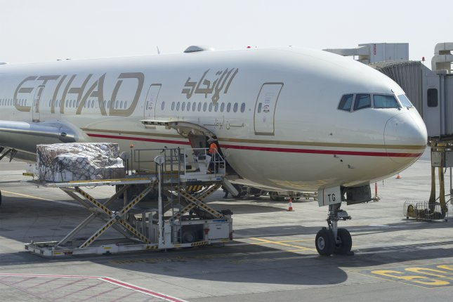 An Etihad plane loads at an Abu Dhabi airport. The airline is facing a lawsuit from an Australian man who claims to have been injured as a result of being seated next to an obese man. Photo by Karasev Victor/Shutterstock.com