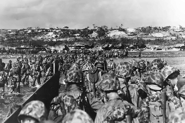 U.S. Marine reinforcements wade ashore to support the beachhead on Okinawa, Japan, on April 1, 1945. File Photo courtesy of the U.S. Department of Defense