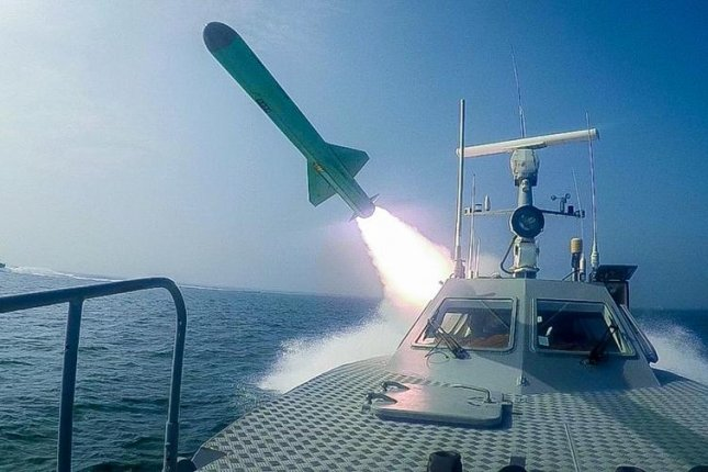 A photo from the Islamic Revolutionary Guard Corps shows an Iranian missile fired at a mock-up of a U.S. aircraft carrier in the strategic Strait of Hormuz, off southern Iran, on Wednesday. Photo by SepahNews/EPA-EFE