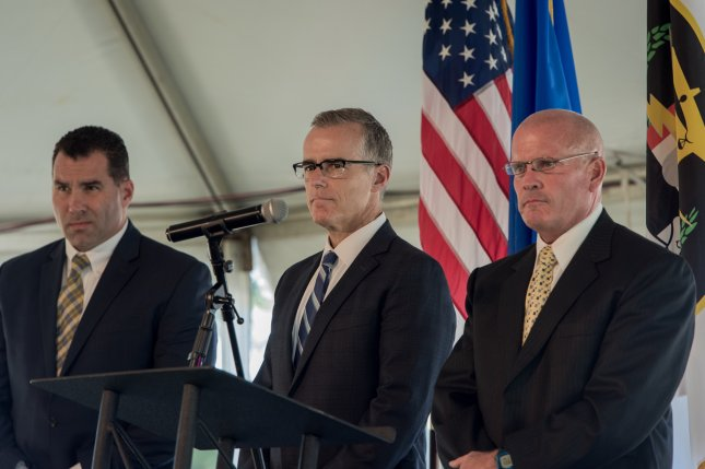 FBI Deputy Director Andrew McCabe (center) reportedly plans to retire in March, when he will be eligible for full pension benefits. McCabe, who served as No. 2 under former Director James Comey, has been a frequent target of attacks from President Donald Trump and congressional Republicans. File photo by UPI
