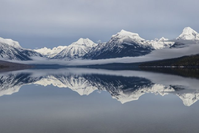 Researchers warn that average temperatures in national parks have increased at twice the rate of other parts of the country while rainfall dropped significantly more in parks than in other areas. Lake McDonald, pictured, is the largest lake in Glacier National Park. Photo by skeeze/Pixabay