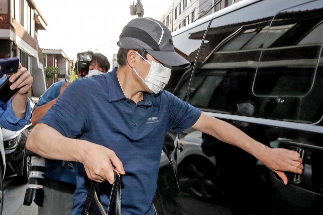 North Korean defector Park Sang-hak, the head of Fighters for a Free North Korea, gets in a car in front of the group's office in Seoul on Friday. Police completed their search and seizure of the office as part of their probe into the group's anti-Pyongyang leafleting campaign. Photo by Yonhap/EPA