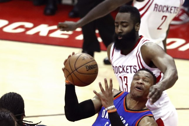 f286c7af34a Oklahoma City Thunder guard Russell Westbrook (C) is fouled by Houston  Rockets guard James Harden (R) while going to the basket in the first half.