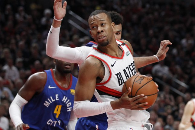3f5e7bcb97cf Portland Trail Blazers guard Rodney Hood (L) suffered a bone bruise in his  knee against the Denver Nuggets on Sunday. He was originally listed as ...