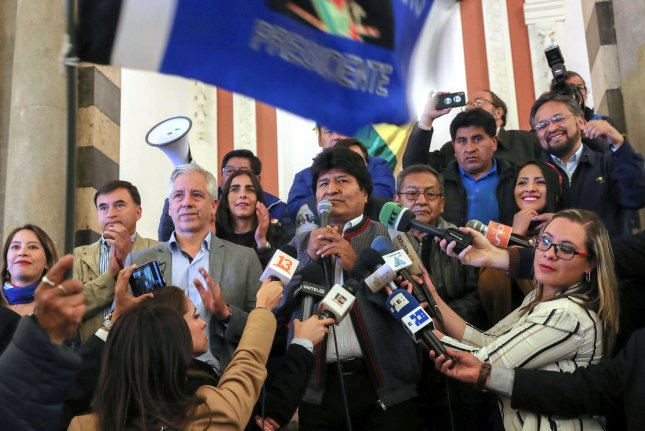 President of Bolivia Evo Morales (C) speaks to the press at the Palacio Quemado of La Paz, Bolivia, Sunday after failing to secure enough votes to win the presidential election outright. Photo by Martin Alipaz/EPA-EFE