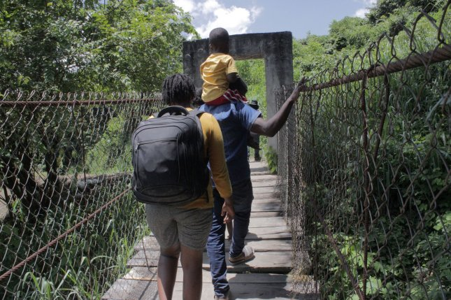 A group of Haitian migrants walk while looking for new exit routes to avoid being detained by Mexican authorities in the municipality of Tapachula in the state of Chiapas, Mexico, on Thursday. Thousands of Haitian migrants have gathered at the Mexican border seeking asylum in the United States. Photo by Juan Manuel Blanco/EPA-EFE
