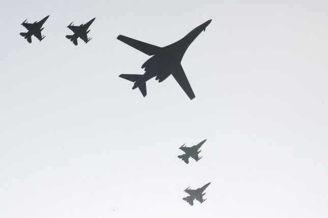 One (C) of two B-1B Lancer bombers deployed by the U.S. military and four South Korean F-15K fighters fly over Osan Air Base, south of Seoul in September. North Korea warned Seoul and Washington about deterrence and declared defense measures a threat on Tuesday. File Photo by Yonhap/UPI