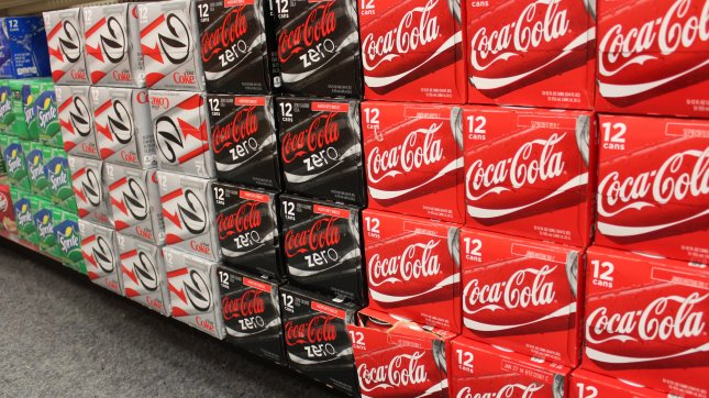 Diet Coke contains the artificial sweetener aspartame, produced from the waste produced by genetically modified E. coli bacteria. (File/UPI/Billie Jean Shaw)