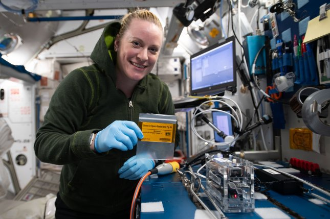 NASA astronaut and microbiologist Kate Rubins holds fruit fly genetic material aboard the International Space Station on December 21 after analyzing the substance using new techniques. Photo courtesy of NASA