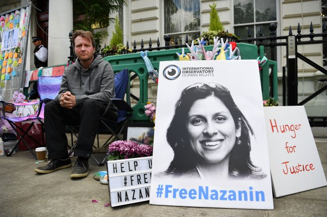 Richard Ratcliffe, husband of imprisoned Nazanin Zaghari-Ratcliffe, protests outside the Iranian Embassy in London in 2019. Nazanin Zaghari-Ratcliffe has been sentenced to a further year in prison and a one-year travel ban after being found guilty of propaganda against the regime in Iran. File Photo by Andy Rain/EPA-EFE