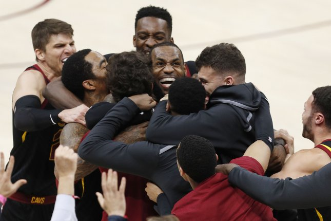 LeBron James (C) of the Cleveland Cavaliers celebrates with teammates. Photo by David Maxwell/EPA-EFE