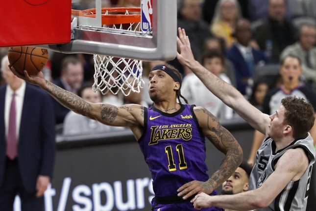 Los Angeles Lakers forward Michael Beasley (L) scored five points in a win against the Oklahoma City Thunder on Thursday in Oklahoma City. Photo by Larry W. Smith/EPA-EFE