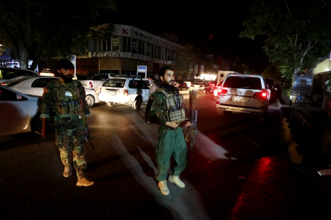 Afghan security officers stands guard outside the emergency hospital in Kabul after a car bomb blast targeted a crowded market in Logar province of Afghanistan, on Thursday. Photo by Jawad Jalali/EPA-EFE