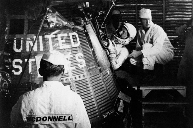 Astronaut Scott Carpenter climbs into Aurora 7 ahead of launching the second American-manned orbital flight on May 24, 1962. File Photo by NASA/UPI