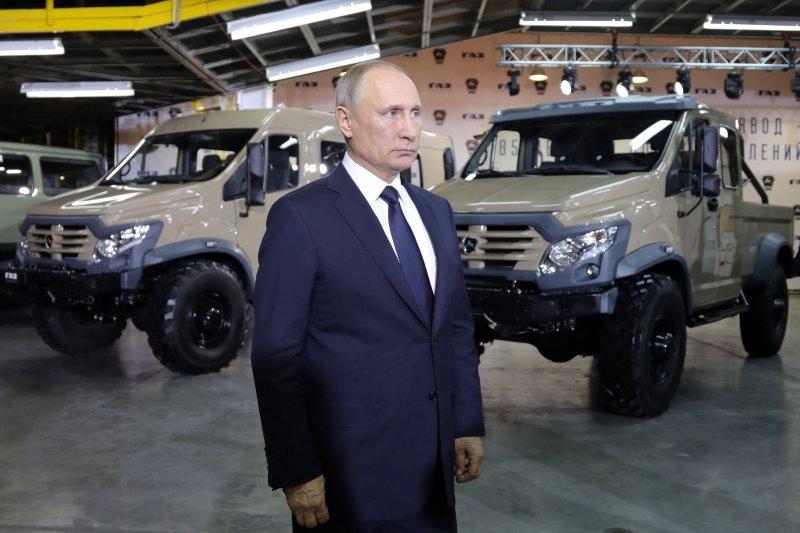 Russian President Vladimir Putin visits the Gorky Automobile Plant in Nizhny Novgorod on Wednesday, where he officially announced he would seek re-election in March. Photo by Michael Klimentyev/Kremlin pool/Sputnik/EPA