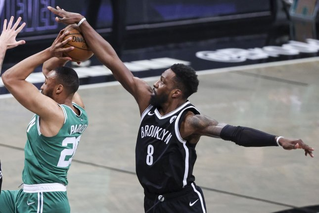 Brooklyn Nets forward Jeff Green (R), shown during a game against the Boston Celtics on May 22, strained his plantar fascia and will be re-evaluated in 10 days. Photo by Justin Lane/EPA-EFE