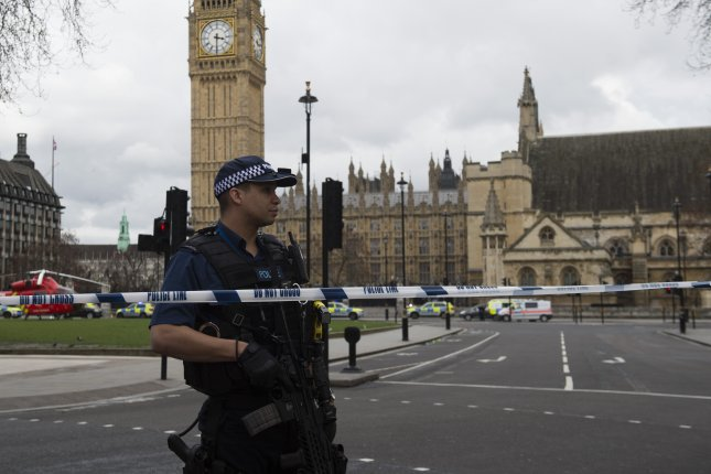 Armed police stand outside Britain's Houses of Parliament in central London on Wednesday after a man killed at least three people and wounded 40 in what authorities said they were treating as a terrorist incident. Photo by Will Oliver/European Pressphoto Agency