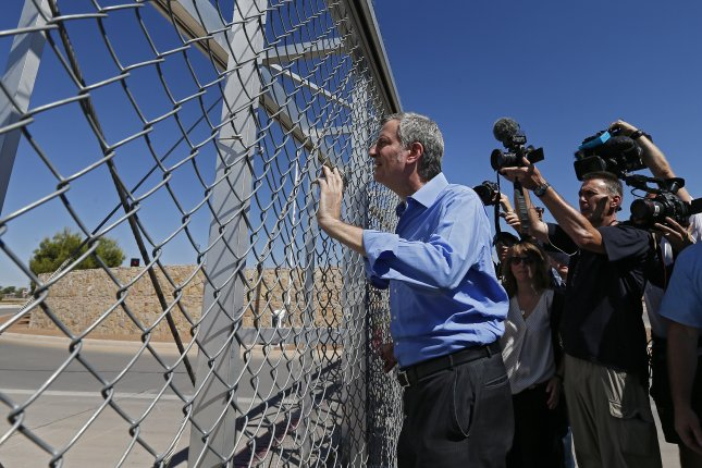New York City Mayor Bill de Blasio stands at the gate of a border crossing entrance asking to see a Border Patrol supervisor after holding a press conference with other U.S. mayors at a tent city across from the Tornillo Port of Entry in Tornillo, Texas, on Thursday. Photo by Larry W. Smith/EPA-EFE