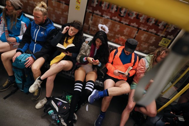 Participants in the No Pants Subway Ride take a commuter train in Berlin on Sunday, Jan. 12, 2020. Improv Everywhere, the performance art group that organizes the annual event, said the 2021 No Pants Subway Ride has been canceled due to the COVID-19 pandemic. File Photo by Hayoung Jeon/EPA-EFE