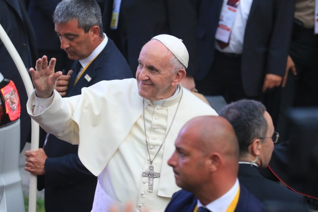 Pope Francis waves to the public upon his arrival to the Nunciature in Lima, Peru, on January 18. He has reactivated his sexual abuse advisory panel. Photo by Sebastian Castaneda/EPA