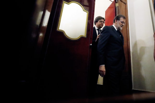 Ousted Spanish Prime Minister Mariano Rajoy leaves Friday after he lost a no-confidence motion at the Lower House in the Spanish Parliament in Madrid. Photo by Javier Lizon/EPA-EFE