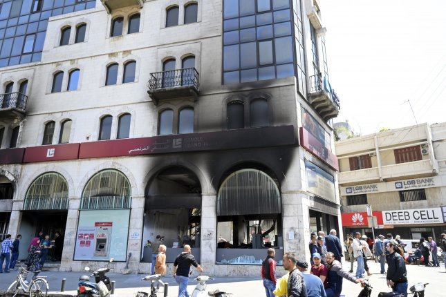 A bank was set ablaze by anti-government protesters at Al Nour Square in Tripoli, Lebanon on April 28. Photo by Wael Hamzeh/EPA-EFE