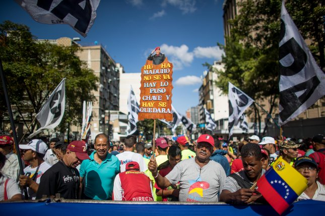 Thousands of supporters of Venezuelan President Nicolas Maduro march in Caracas, Venezuela, earlier this year amid an economic crisis that's hampered many sectors of industry. Photo by Miguel Gutierrez/EPA-EFE