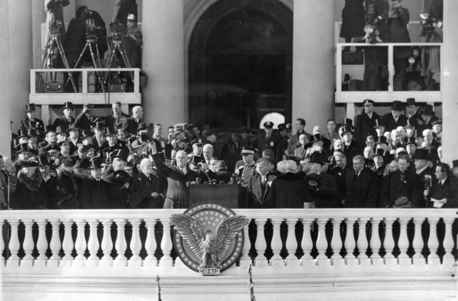 President Franklin D. Roosevelt takes the oath of office at his at his third inauguration in Washington, D.C., on January 20, 1941. Next to the President are Charles Evans Hughes, James Roosevelt and Henry Wallace. File Photo courtesy FDR Presidential Library