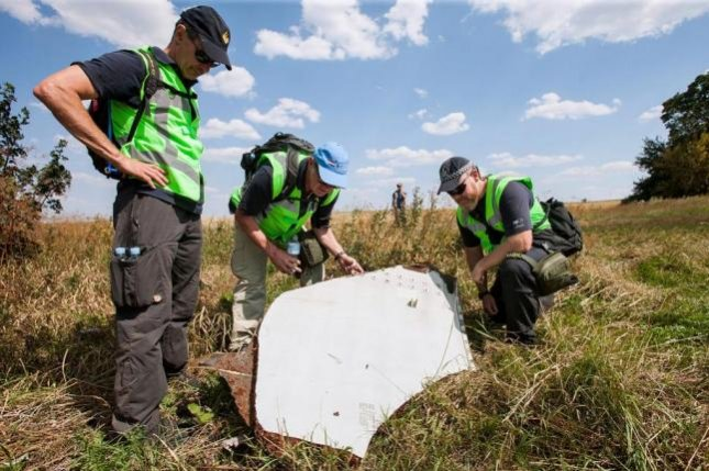 Dutch investigators collect debris from Malaysia Airlines Flight 17, which crashed on July 17, 2014, near Ukraine's border with Russia. Malaysia Airlines reached a settlement agreement with the relatives of most victims who died on Flight MH17 on Sunday, the second anniversary of the crash. File Photo courtesy of Dutch Ministry of Defense.