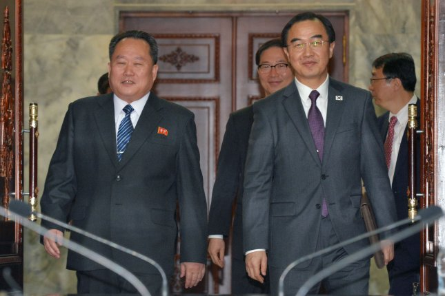 South Korea's outgoing Unification Minister Cho Myoung-gyon (R) commented on the Sohae rocket launch site in Tongchang-ri, North Korea, on MOnday. EPA-EFE/YONHAP SOUTH KOREA OUT