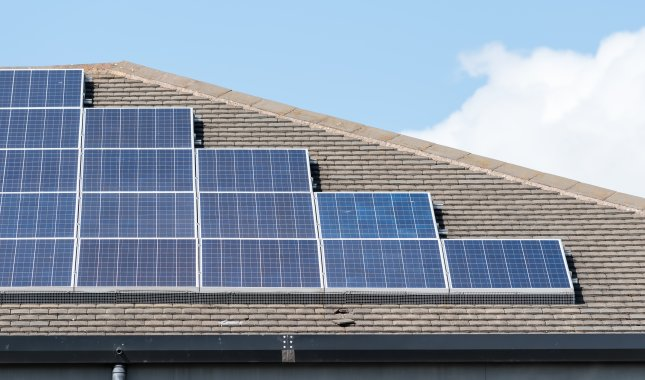 Solar panels are shown on a roof top. File Photo by Craig Russell/Shutterstock