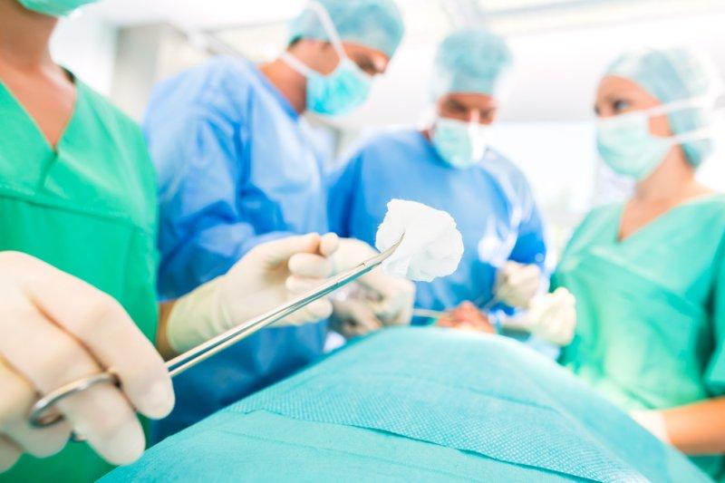 Doctors perform surgery in a hospital operating room. (UPI/Shutterstock/Kzenon)