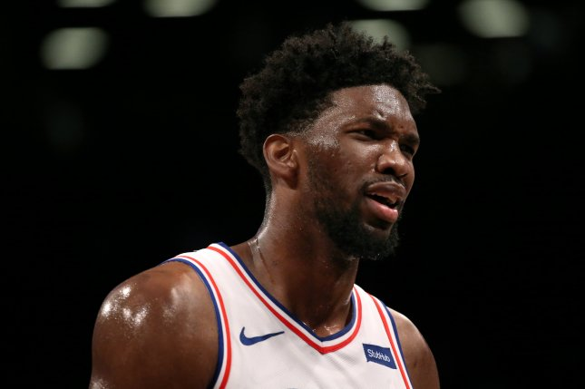 Philadelphia 76ers center Joel Embiid was averaging 30.3 points, 13.5 rebounds and 3.3 assists in the 76ers' previous four games in the NBA's bubble before leaving Sunday's game against the Portland Trail Blazers. File Photo by Peter Foley/EPA-EFE