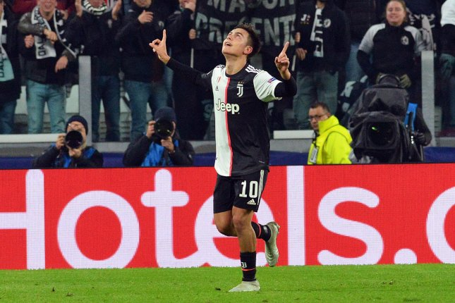 Juventus forward Paulo Dybala celebrates after scoring during the UEFA Champions League against Atletico Madrid on Tuesday at Allianz Stadium in Turin, Italy. Photo by Andrea Di Marco/EPA-EFE