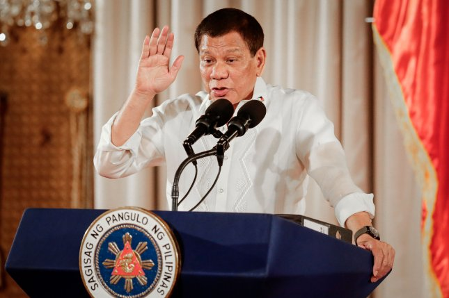 Philippine President Rodrigo Duterte gestures during his speech with the Volunteers Against Crime and Corruption at the Malacanang Palace in Manila. Photo by Mark R. Cristino/EPA