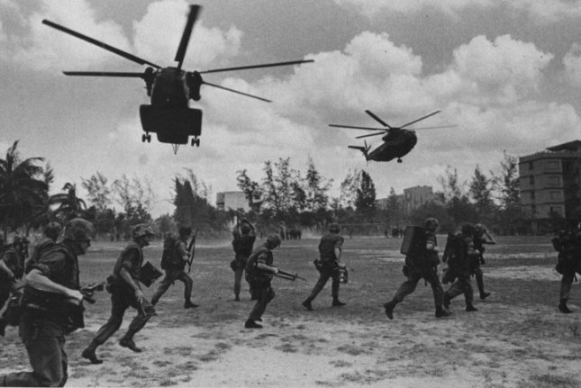 U.S. Marines assist in the evacuation of Phnom Penh, Cambodia, on April 12, 1975. File Photo courtesy of the U.S. Navy