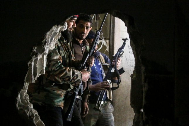 President Trump appeared Tuesday to have confirmed the end of a CIA program to arm and train Syrian rebels battling the government of President Bashar al-Assad. File Photo by Mohammed Badra/EPA
