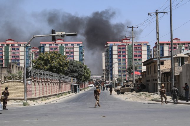 Security officials patrol the scene of a suicide bombing near a governmental institution in downtown Kabul, Afghanistan. A U.N. report Monday said hundreds of civilian casualties have been killed so far this year in fighting. File Photo by Hedayatullah Amid/EPA-EFE