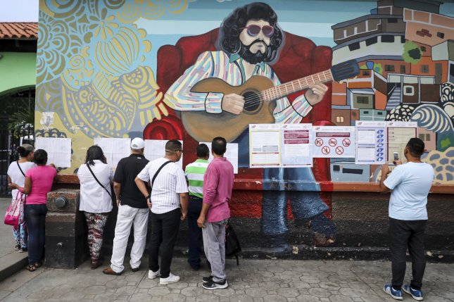 People check their names on a list at a polling station to vote on the National Constituent Assembly in Caracas, Venezuela, on Sunday. Photo by Miguel Gutierrez/EPA