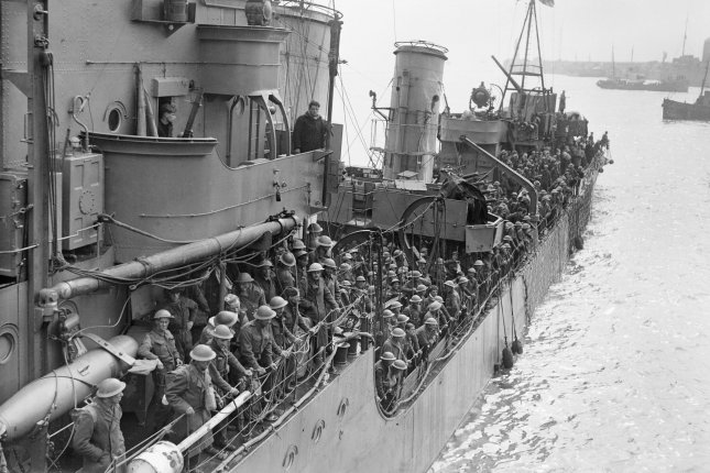 Troops evacuated from Dunkirk on a destroyer are about to berth at Dover, England, on May 31, 1940. The evacuation of Dunkirk began May 26. File Photo courtesy of the Imperial War Museum