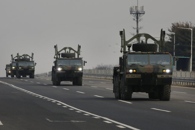 U.S. troop vehicles mobilize near the South Korean town of Paju bordering North Korea on Thursday amid heightened tensions raised by North Korea's threat of attack on South Korea. The supreme command of the North Korea's army has threatened to strike the presidential office of Cheong Wa Dae and U.S. military installations in the Asia-Pacific region, denouncing South Korea's plan to start a large-scale joint military exercise with the United States early next month. Photo courtesy of Yonhap/UPI
