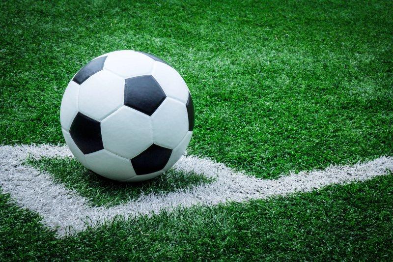 Soccer ball on soccer field. Photo by Oris Arisara/Shutterstock