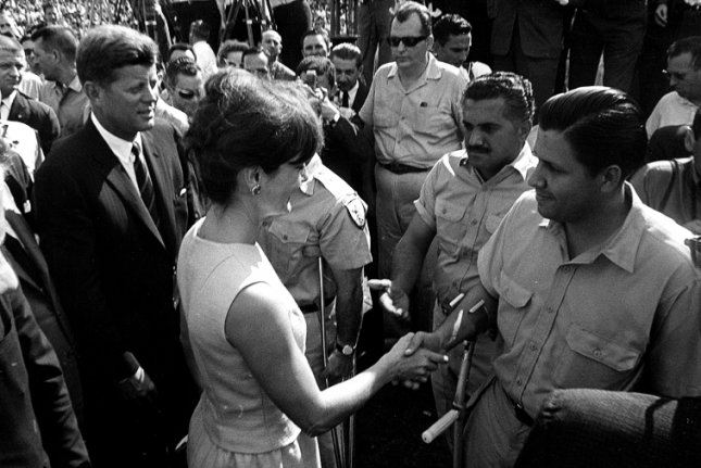 President John F. Kennedy and Jacqueline Kennedy greet members of the 2506 Cuban Invasion Brigade on December 29, 1962, in Miami at the Orange Bowl Stadium. Photo by Cecil Stoughton/White House/John F. Kennedy Presidential Library