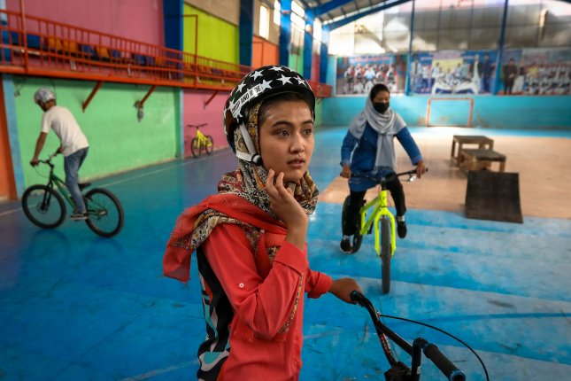 A young Afghan prepares before an exercise at a freestyle cycling club in Kabul, Afghanistan, on June 29, only weeks before the Taliban seized control of the country. File photo by Hedayatullah Amid/EPA-EFE