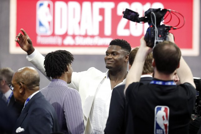 Duke Blue Devils star Zion Williamson (C) waves to fans before the start of the 2019 NBA Draft on Thursday night at the Barclays Center in Brooklyn, New York. Photo by Jason Szenes/EPA-EFE