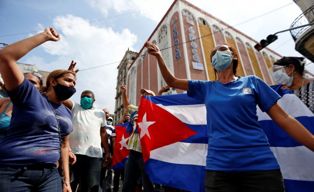Protesters attend a pro-government rally in Havana, Cuba, on July 11, 2021. Thousands of Cubans took the streets on Sunday to protest against Cuba's government, in what is considered the first major protest in the last 60 years. Photo by Ernesto Mastrascusa/EPA-EFE