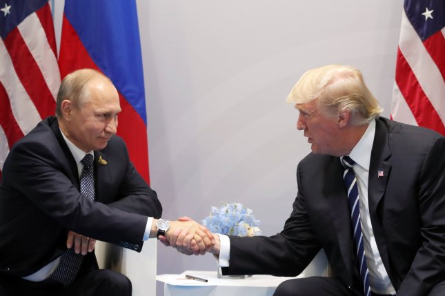 Russian President Vladimir Putin (L) and U.S. President Donald J. Trump (R) shake hands during a meeting on the sidelines of the G20 summit in Hamburg, Germany, on July 7. On Sunday, Putin announced that the United States must reduce embassy and consulate personnel by 775. Photo by Michael Klimentyev/EPA/Kremlin Pool