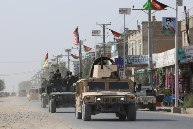 Afghan security forces drive along a road as the Taliban launched coordinated attacks to capture the city, in Kunduz, Afghanistan on August 31. Photo by EPA-EFE